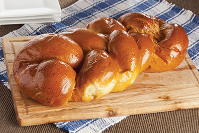 Challah is a loaf of white leavened bread